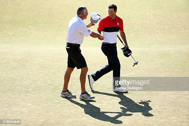 Adam Scott of Australia celebrates with his caddie Steve Williams on the 18th green after a sixunder par 64 during the final round of the 115th US...