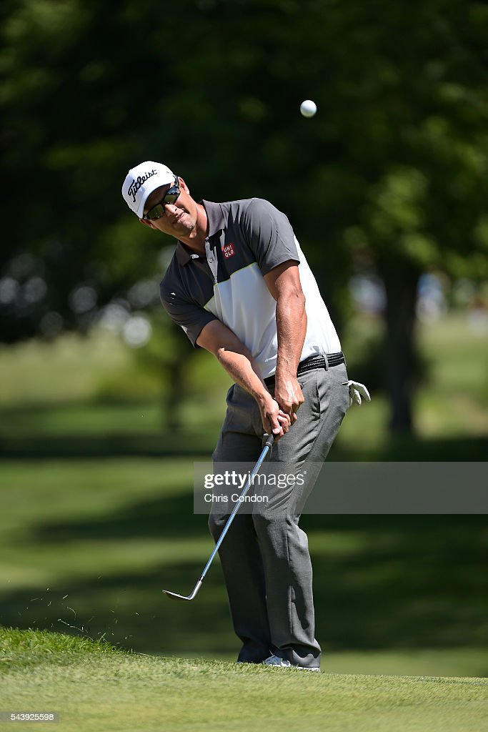 <a gi-track='captionPersonalityLinkClicked' href=/galleries/search?phrase=Adam+Scott+-+Golfer&family=editorial&specificpeople=202039 ng-click='$event.stopPropagation()'>Adam Scott</a> of Australia chips in for birdie on the first green green during the first round of the World Golf Championships-Bridgestone Invitational at Firestone Country Club on June 30, 2016 in Akron, Ohio.