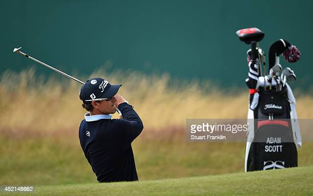 Adam Scott of Australia chips to a green during a practice round prior to the start of the 143rd Open Championship at Royal Liverpool on July 14 2014...