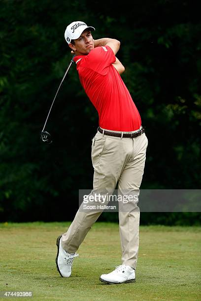 Adam Scott of Australia hits a shot on the 6th tee during the third round of the Crowne Plaza Invitational at the Colonial Country Club on May 23...