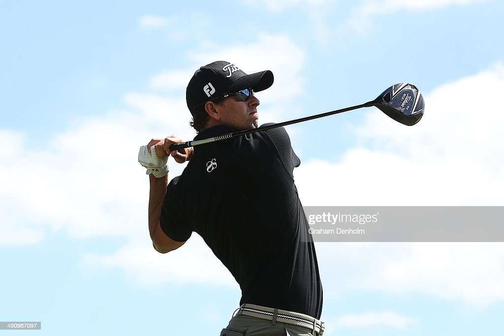 Adam Scott of Australia hits a tee shot during day one of the World Cup of Golf at Royal Melbourne Golf Course on November 21, 2013 in Melbourne, Australia.