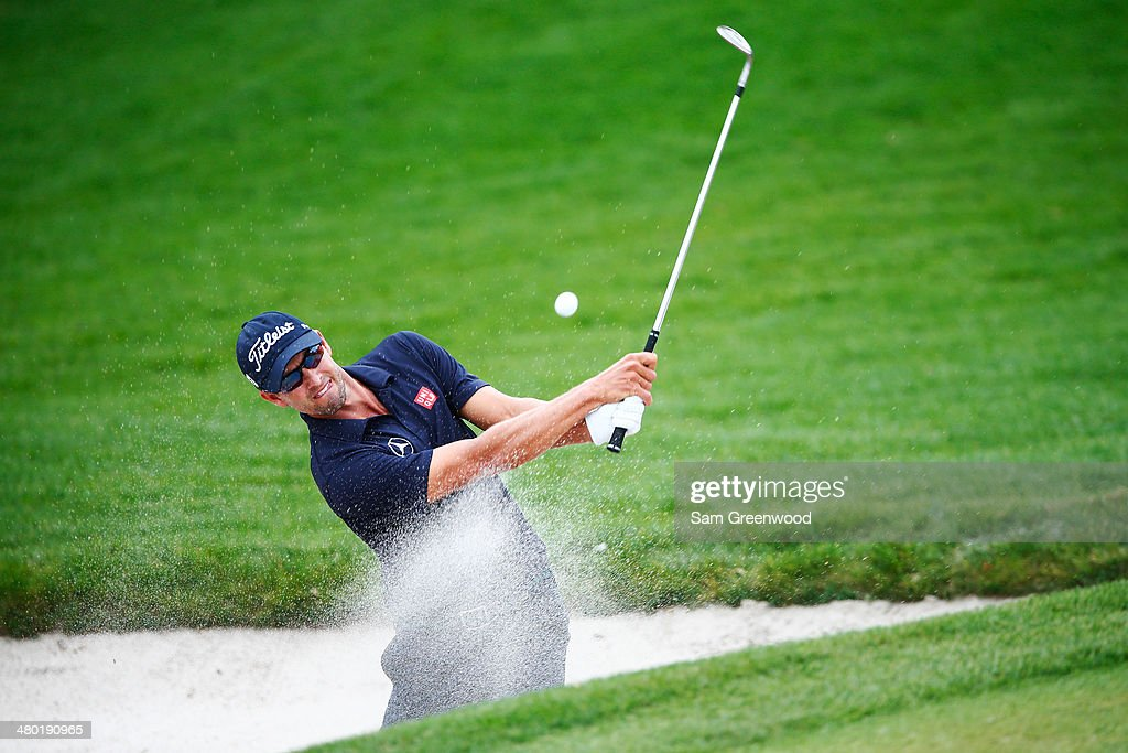 Adam Scott of Australia hits an approach shot from a greenside bunker on the first hole during the final round of the Arnold Palmer Invitational presented by MasterCard at the Bay Hill Club and Lodge on March 23, 2014 in Orlando, Florida.
