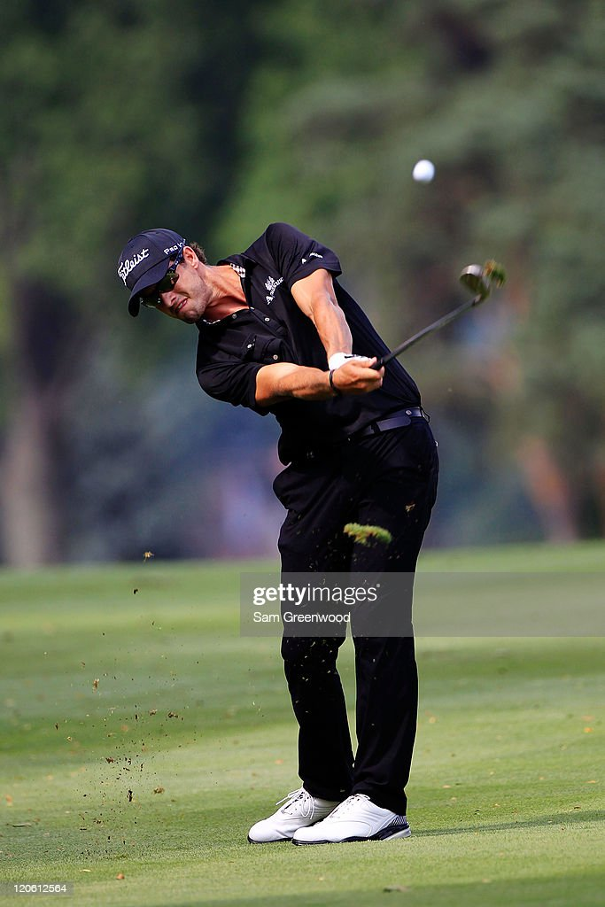 <a gi-track='captionPersonalityLinkClicked' href=/galleries/search?phrase=Adam+Scott+-+Golfer&family=editorial&specificpeople=202039 ng-click='$event.stopPropagation()'>Adam Scott</a> of Australia hits an approach shot on the 11th hole during the final round of the World Golf Championships-Bridgestone Invitational on the South Course at Firestone Country Club on August 7, 2011 in Akron, Ohio.