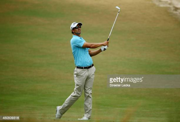 Adam Scott of Australia hits an approach shot on the eighth hole during the first round of the 114th US Open at Pinehurst Resort Country Club Course...