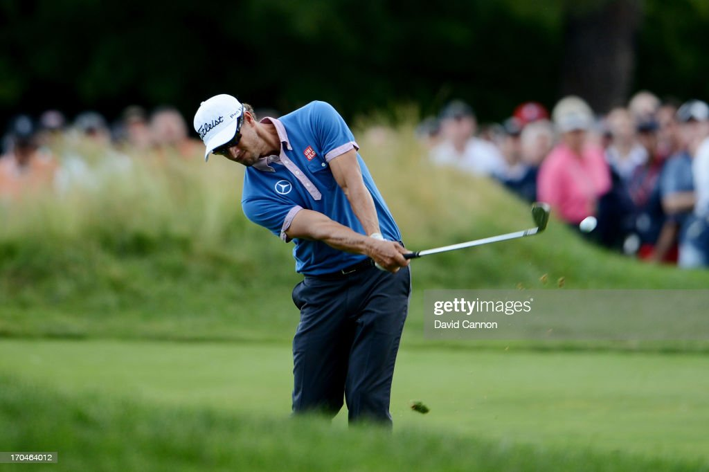 Adam Scott of Australia hits an approach shot on the first hole during Round One of the 113th US Open at Merion Golf Club on June 13 2013 in Ardmore...