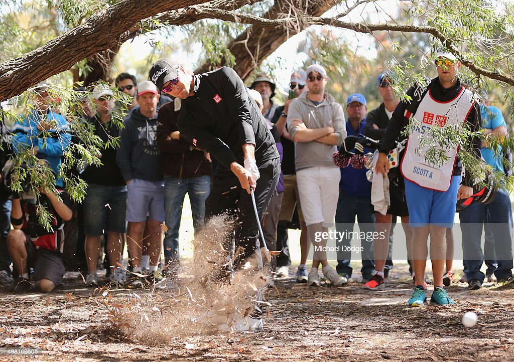 Adam Scott of Australia hits an approach shot out of the rough during day three of the 2015 Australian Masters at Huntingdale Golf Club on November 21, 2015 in Melbourne, Australia.