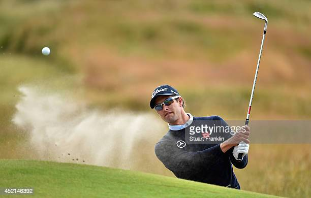 Adam Scott of Australia hits from a bunker during a practice round prior to the start of the 143rd Open Championship at Royal Liverpool on July 14...