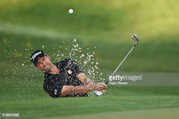 Adam Scott of Australia hits from a green side bunker during the third round of the Arnold Palmer Invitational Presented by MasterCard at Bay Hill...