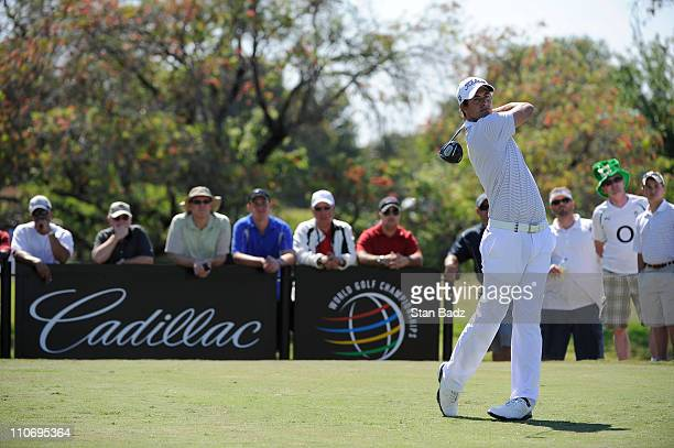 Adam Scott of Australia hits from the fifth tee box during the final round of the World Golf ChampionshipsCadillac Championship at TPC Blue Monster...