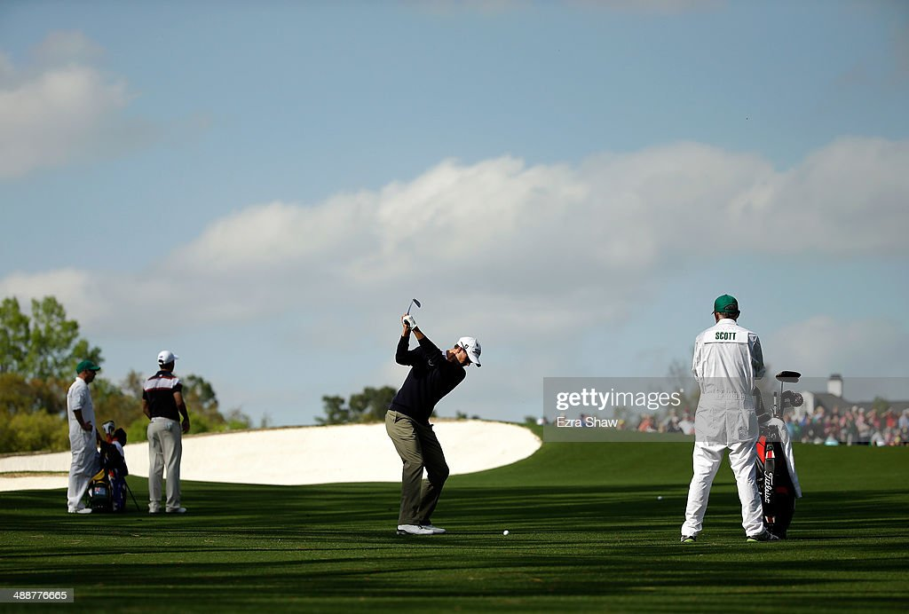 Adam Scott of Australia hits his approach shot on the 18th hole during a practice round at Augusta National Golf Club on April 8, 2014 in Augusta, Georgia.