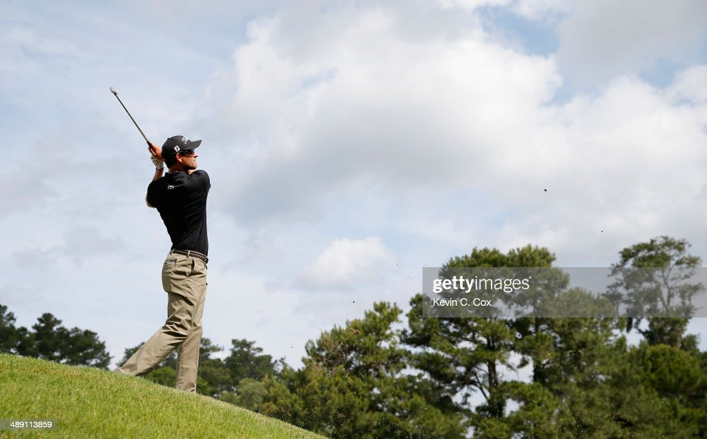 Adam Scott of Australia hits his approach shot on the seventh hole during the third round of THE PLAYERS Championship on the stadium course at TPC Sawgrass on May 10, 2014 in Ponte Vedra Beach, Florida.