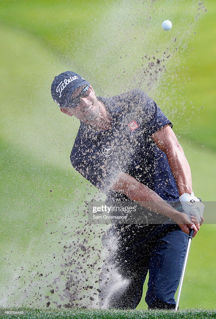 Adam Scott of Australia hits his second shot from a bunker on the seventh hole during the final round of the Arnold Palmer Invitational presented by MasterCard at the Bay Hill Club and Lodge on March 23, 2014 in Orlando, Florida.