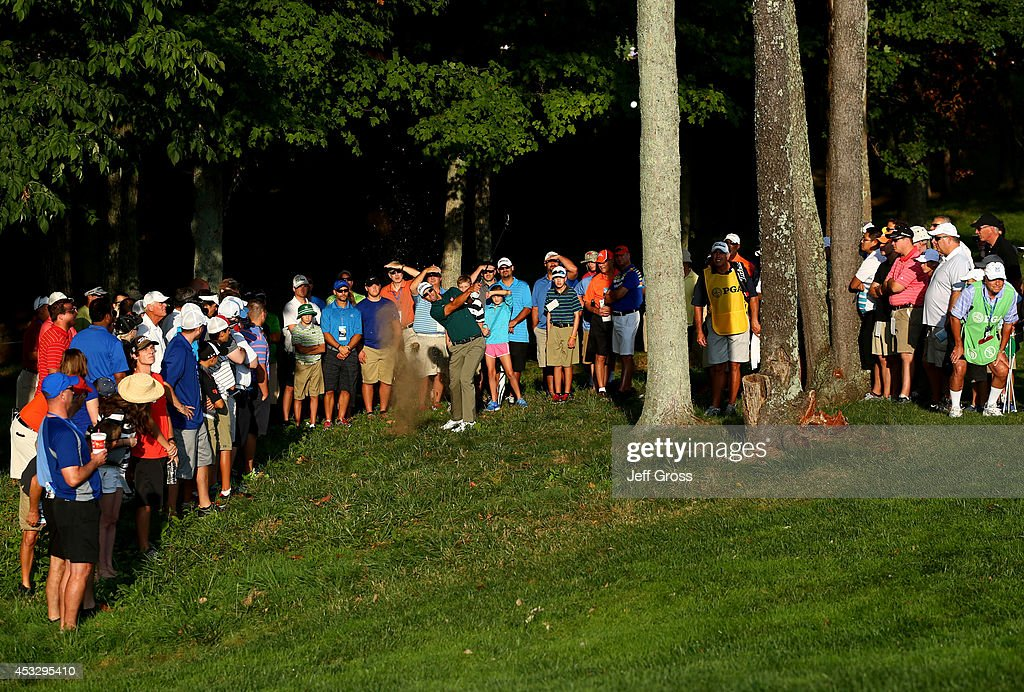 Adam Scott of Australia hits his second shot from the rough on the tenth hole during the first round of the 96th PGA Championship at Valhalla Golf...