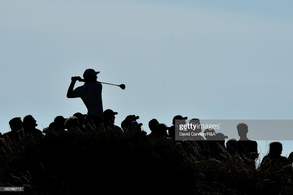 Adam Scott of Australia hits his tee shot on the 12th hole as a gallery of spectators look on during the first round of The 143rd Open Championship at Royal Liverpool on July 17, 2014 in Hoylake, England.
