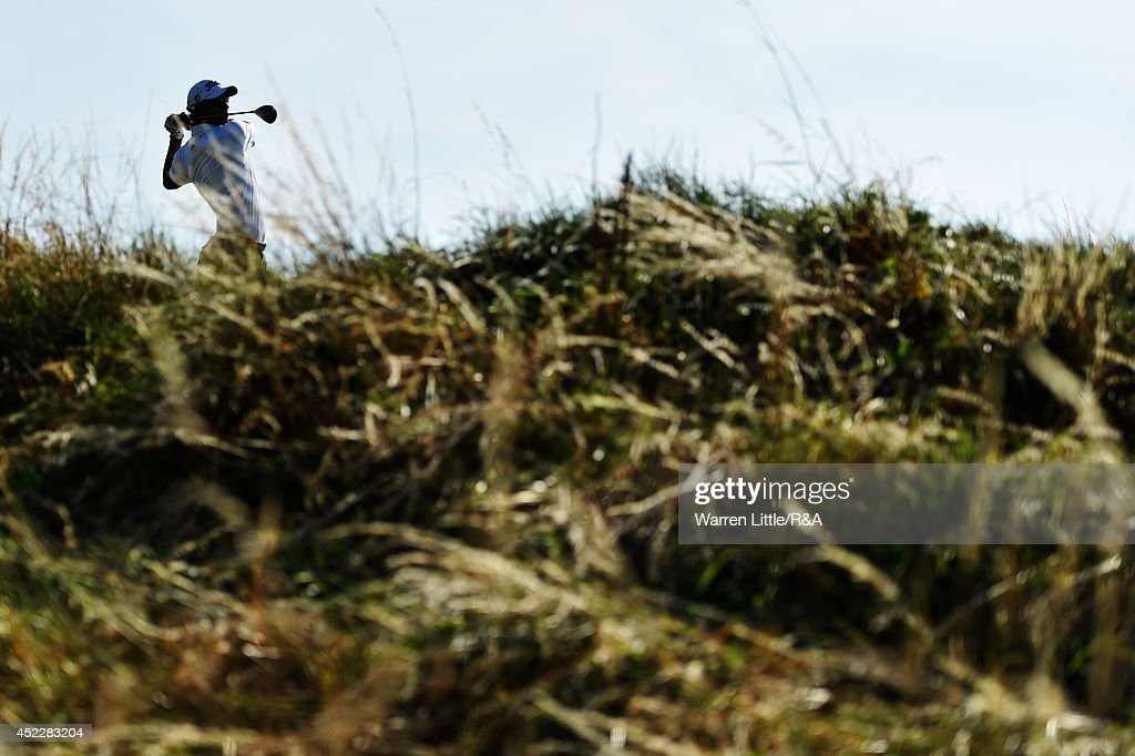 Adam Scott of Australia hits his tee shot on the 12th hole during the first round of The 143rd Open Championship at Royal Liverpool on July 17, 2014 in Hoylake, England.