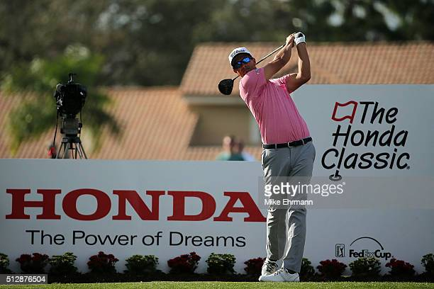 Adam Scott of Australia hits his tee shot on the 12th hole during the final round of the Honda Classic at PGA National Resort Spa Champions Course on...
