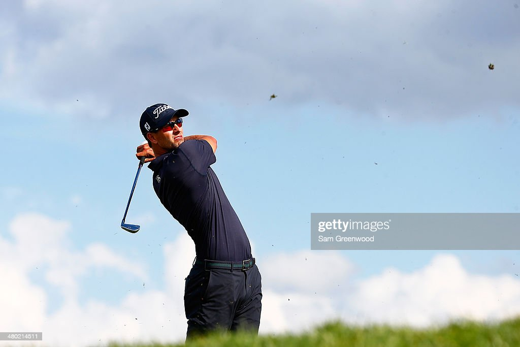 Adam Scott of Australia hits his tee shot on the 14th hole during the final round of the Arnold Palmer Invitational presented by MasterCard at the Bay Hill Club and Lodge on March 23, 2014 in Orlando, Florida.