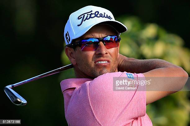 Adam Scott of Australia hits his tee shot on the 14th hole during the final round of the Honda Classic at PGA National Resort Spa Champions Course on...
