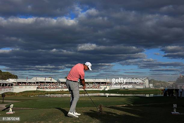 Adam Scott of Australia hits his tee shot on the 17th hole during the final round of the Honda Classic at PGA National Resort Spa Champions Course on...
