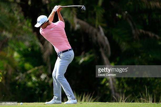 Adam Scott of Australia hits his tee shot on the eighth hole during the final round of the Honda Classic at PGA National Resort Spa Champions Course...