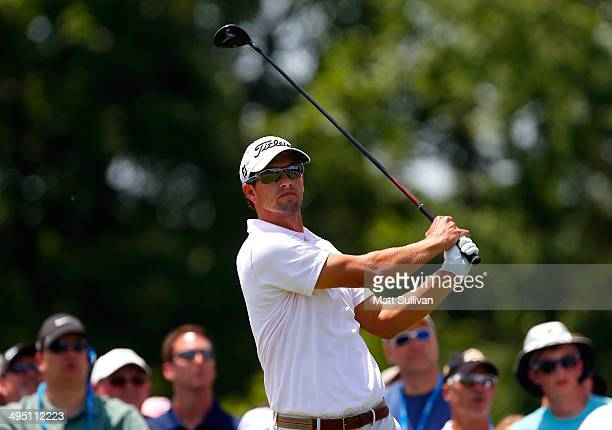 Adam Scott of Australia hits his tee shot on the first hole during the final round of the Memorial Tournament presented by Nationwide Insurance at...