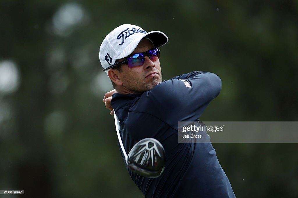 Adam Scott of Australia hits his tee shot on the fourth hole during the first round of the Wells Fargo Championship at Quail Hollow on May 5, 2016 in Charlotte, North Carolina.