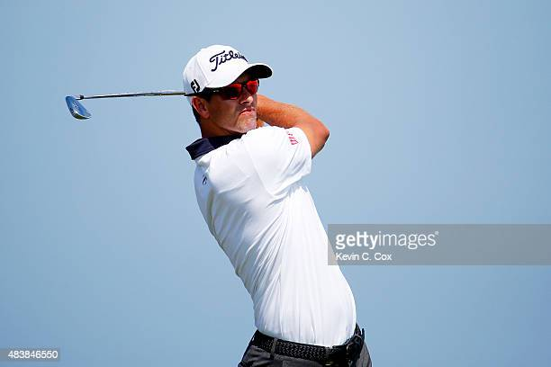Adam Scott of Australia hits his tee shot on the third hole during the first round of the 2015 PGA Championship at Whistling Straits on August 13...