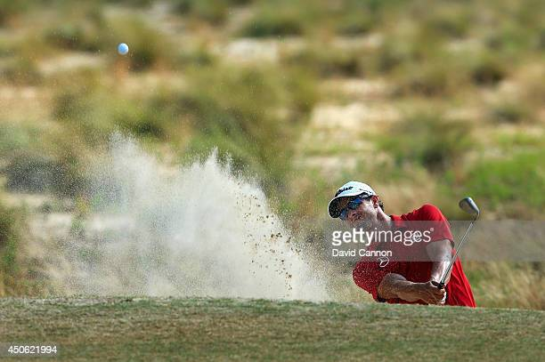 Adam Scott of Australia hits his third shot from a bunker on the 12th hole during the third round of the 114th US Open at Pinehurst Resort Country...