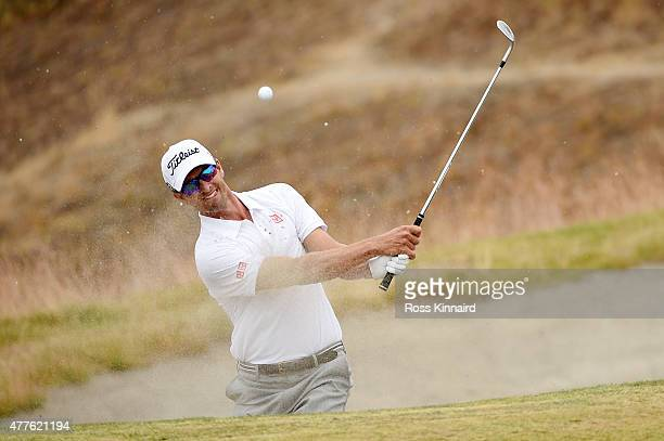 Adam Scott of Australia hits his third shot from a bunker on the ninth hole during the first round of the 115th US Open Championship at Chambers Bay...