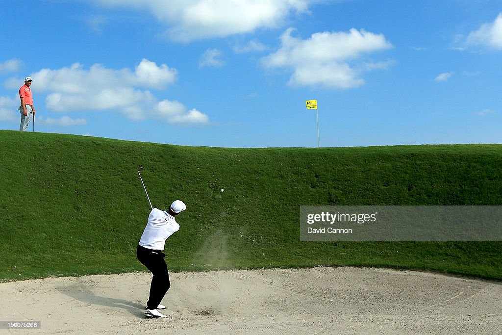 Adam Scott of Australia hits out of the sand on the 15th hole during Round One of the 94th PGA Championship at the Ocean Course on August 9, 2012 in Kiawah Island, South Carolina.