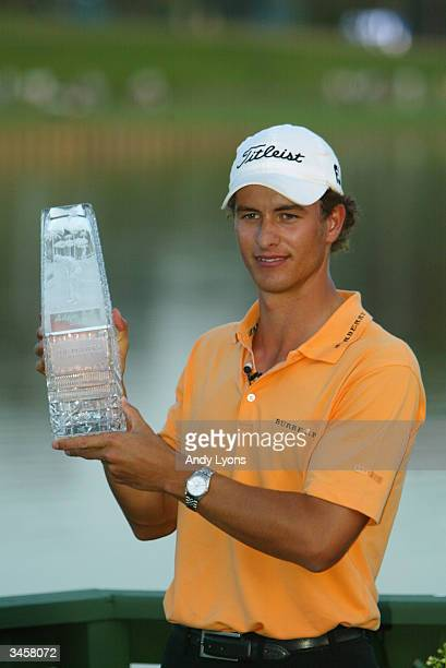 Adam Scott of Australia holds the trophy after winning The Players Championship on March 28 2004 at the TPC at Sawgrass in Ponte Vedra Florida