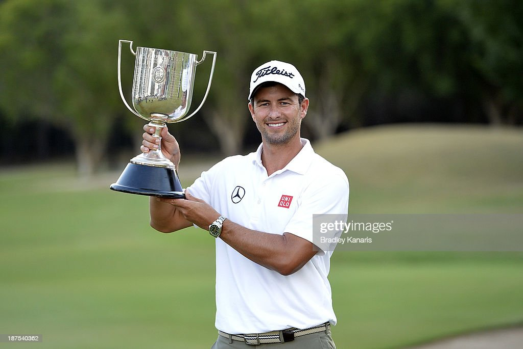 Adam Scott of Australia holds up the Kirkwood Cup after claiming victory during day four of the PGA Royal Pines on November 10, 2013 in Gold Coast, Australia.