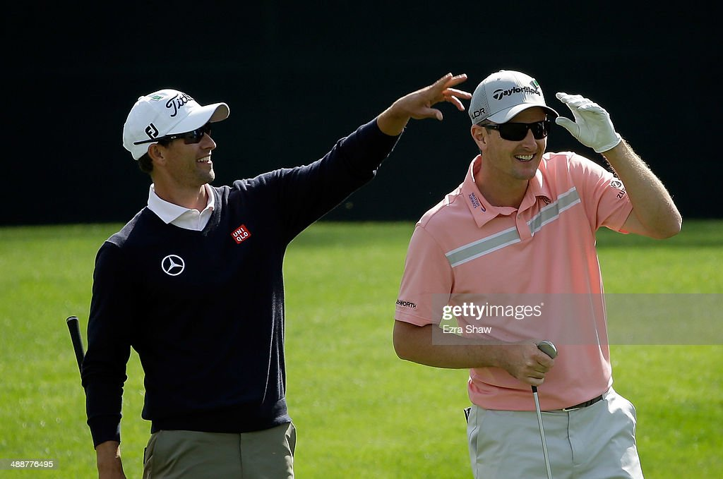 Adam Scott of Australia jokes around with <a gi-track='captionPersonalityLinkClicked' href=/galleries/search?phrase=Justin+Rose&family=editorial&specificpeople=171559 ng-click='$event.stopPropagation()'>Justin Rose</a> of England after Rose skipped a ball across the 16th hole during a practice round at Augusta National Golf Club on April 8, 2014 in Augusta, Georgia.