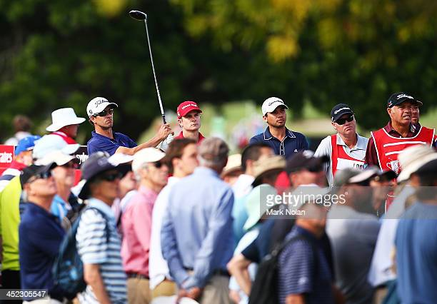 Adam Scott of Australia Kevin Streelman of the USA and Jason Day of Australia prepare to tee off during day one of the 2013 Australian Open at Royal...