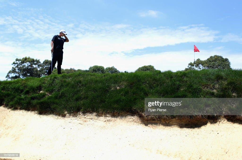 Adam Scott of Australia looks on during round three of the 2012 Australian Open at The Lakes Golf Club on December 8, 2012 in Sydney, Australia.
