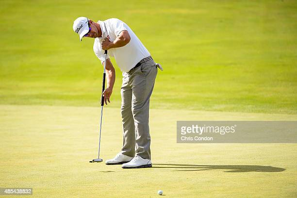 Adam Scott of Australia makes an eagle putt on the 12th hole green during the first round of The Barclays at Plainfield Country Club on August 27...