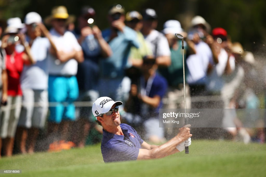 Adam Scott of Australia plays a bunker shot during day one of the 2013 Australian Open at Royal Sydney Golf Club on November 28, 2013 in Sydney, Australia.