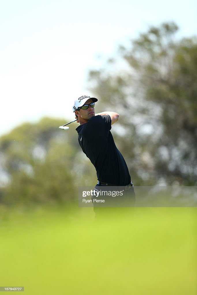 Adam Scott of Australia plays a fairway shot during round three of the 2012 Australian Open at The Lakes Golf Club on December 8, 2012 in Sydney, Australia.