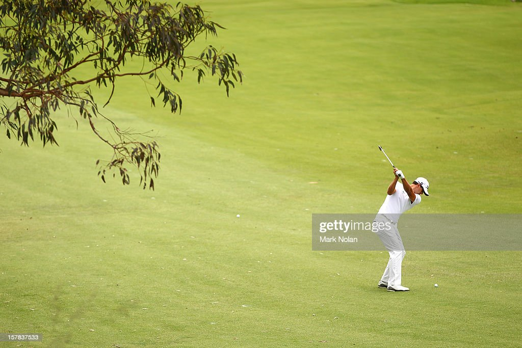 Adam Scott of Australia plays a fairway shot during round two of the 2012 Australian Open at The Lakes Golf Club on December 7, 2012 in Sydney, Australia.