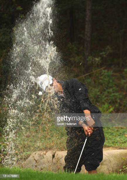 Adam Scott of Australia plays a shot from the water on the eighth hole during the third round of the WGCHSBC Champions at Sheshan International Golf...