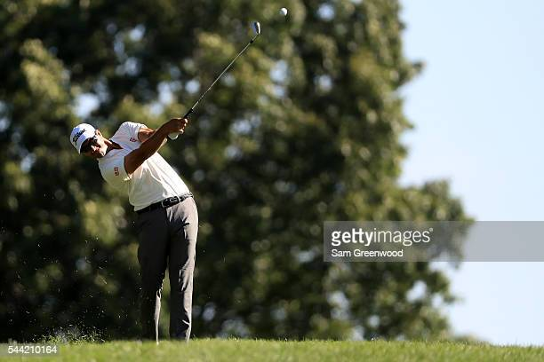 Adam Scott of Australia plays a shot on the 16th hole during the second round of the World Golf Championships Bridgestone Invitational at Firestone...