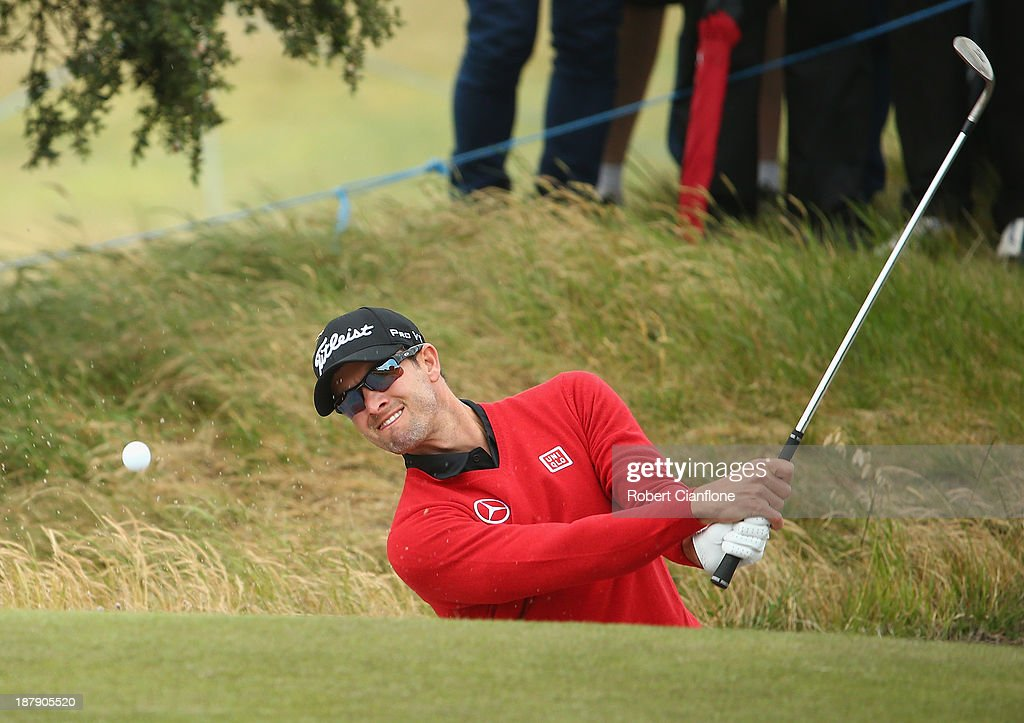 Adam Scott of Australia plays a shot out of the bunker during round one of the 2013 Australian Masters at Royal Melbourne Golf Course on November 14, 2013 in Melbourne, Australia.