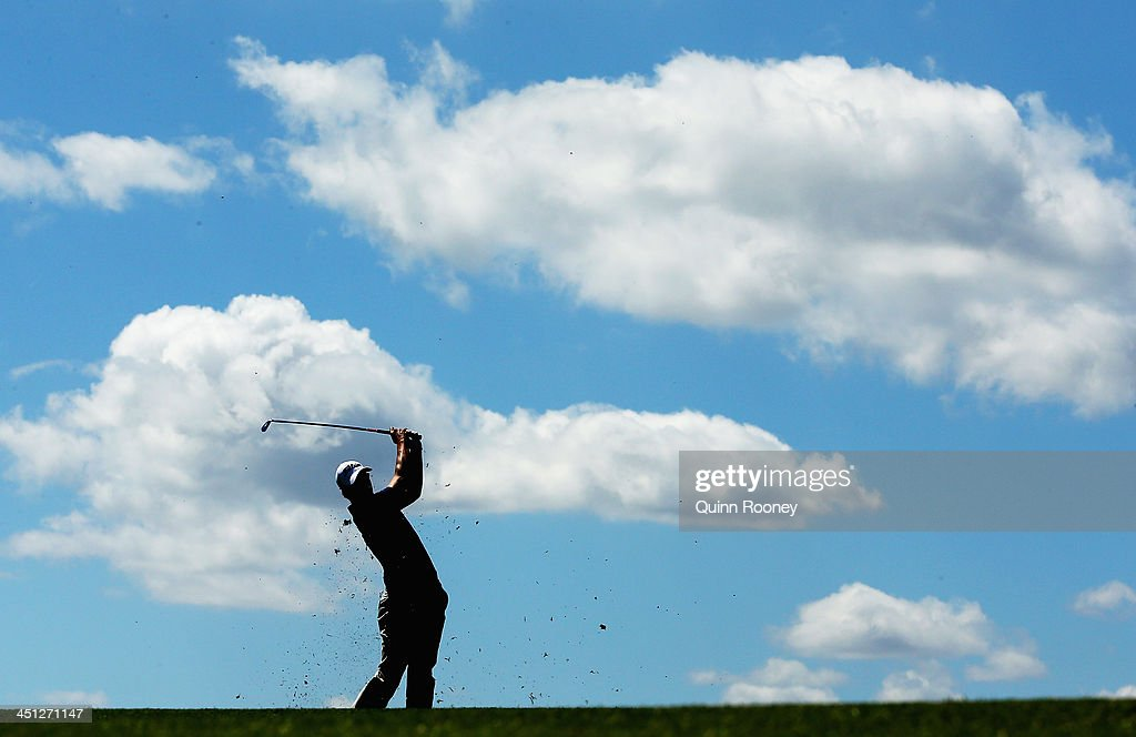 Adam Scott of Australia plays an approach shot during day two of the World Cup of Golf at Royal Melbourne Golf Course on November 22, 2013 in Melbourne, Australia.