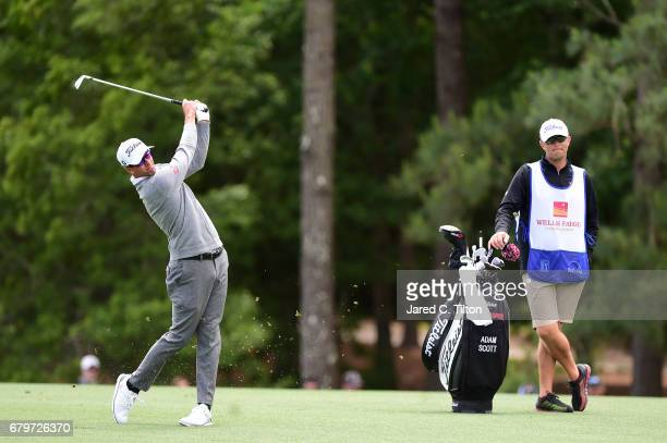 Adam Scott of Australia plays an approach shot on the 12th hole during round three of the Wells Fargo Championship at Eagle Point Golf Club on May 6...