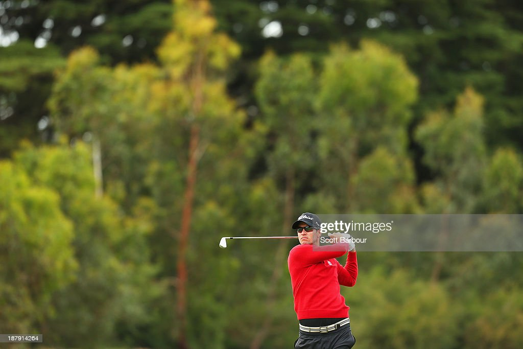 Adam Scott of Australia plays an approach shot on the 15th hole during round one of the 2013 Australian Masters at Royal Melbourne Golf Course on November 14, 2013 in Melbourne, Australia.