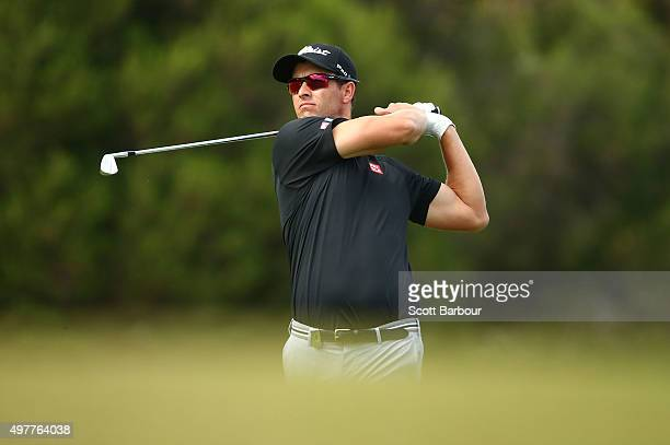Adam Scott of Australia plays an approach shot on the 17th hole during day one of the 2015 Australian Masters at Huntingdale Golf Course on November...