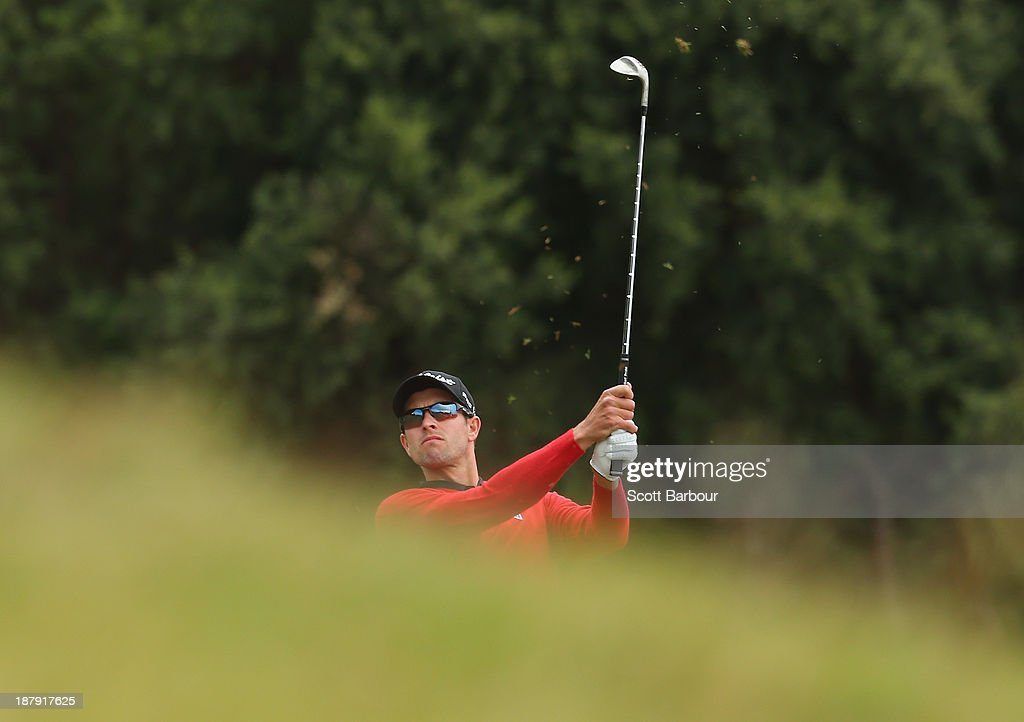 Adam Scott of Australia plays an approach shot on the 6th hole during round one of the 2013 Australian Masters at Royal Melbourne Golf Course on November 14, 2013 in Melbourne, Australia.