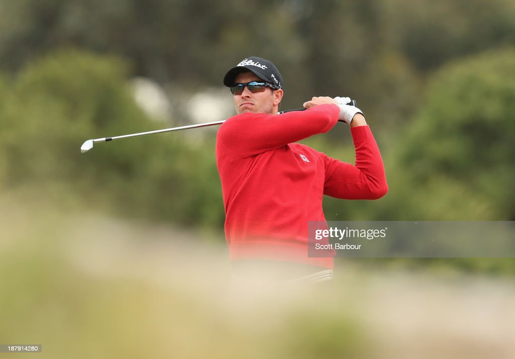 Adam Scott of Australia plays an approach shot on the 9th hole during round one of the 2013 Australian Masters at Royal Melbourne Golf Course on November 14, 2013 in Melbourne, Australia.