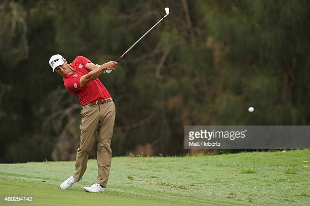 Adam Scott of Australia plays his approach shot on the 15th during day one of the 2014 Australian PGA Championship at Royal Pines Resort on December...
