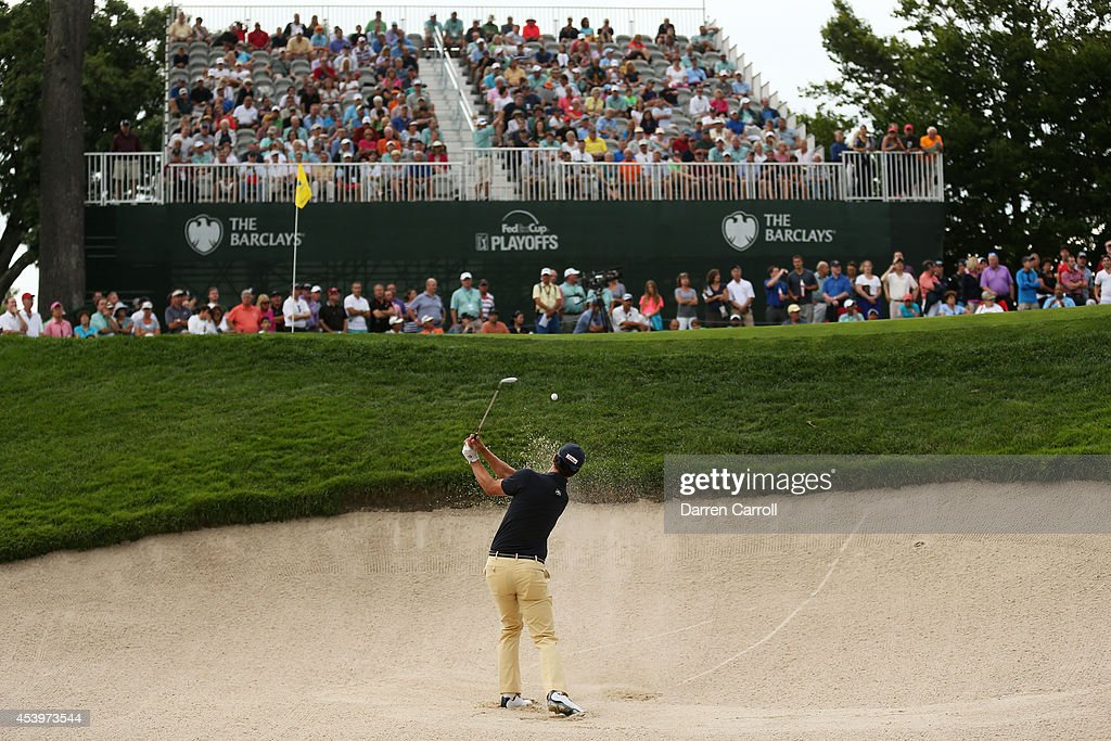 Adam Scott of Australia plays his fourth shot on the 17th hole during the second round of The Barclays at The Ridgewood Country Club on August 22, 2014 in Paramus, New Jersey.